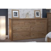 Product photograph showing Messina Oak 7 Drawer Wide Chest