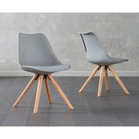 Product photograph showing Oscar Light Grey Faux Leather Round Leg Dining Chairs