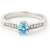 Blue Topaz and Diamond Shoulder Set Ring in 9ct White Gold