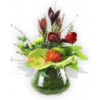 Burgundy and Green Flowers in a Glass Vase