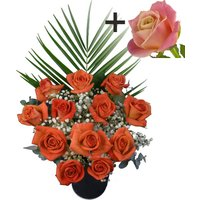 A single Peach Rose surrounded by 11 Orange Roses