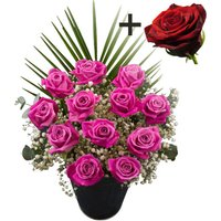 A single Red Rose surrounded by 11 Pink Roses