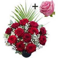 A single Pink Rose surrounded by 11 Deep Red Naomi Roses