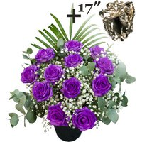 A single 17Inch Silver Dipped Rose surrounded by 11 Purple Roses
