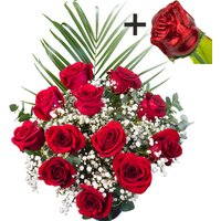 A single CHOCOLATE Rose surrounded by 11 Bright Red Freedom Roses
