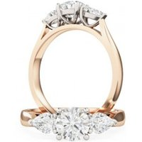 An elegant Round Brilliant Cut diamond ring with Pear shoulder stones in 18ct rose & white gold - Elegant Gifts