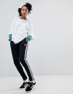 Read more about Adidas originals adicolor three stripe track pants in black - black