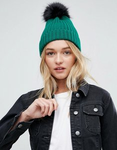 Read more about Asos green rib beanie with black faux fur pom - green