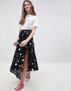 Read more about Asos design asymmetric hem midi skirt in star print - white black