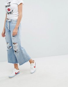Read more about Tommy jeans annie mid rise culotte with raw hem and ripped knee - lightwash denim