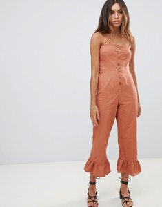 Read more about Asos design cotton frill hem jumpsuit with square neck and button detail - rust