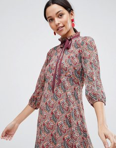Read more about Traffic people long sleeve printed shift dress with bow detail - red