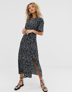 Read more about New look ditsy floral print midi dress in black