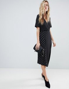 Read more about Asos midi wrap dress in mixed spot print with asymmetric hem - mono polka dot