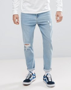Read more about Asos tapered jeans in light wash with rips - light wash vintage
