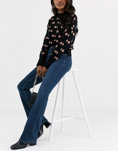 Read more about Pieces flared jeans in dark blue