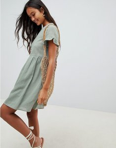 Read more about Asos design smock mini dress in grid texture with frill sleeve - sage green