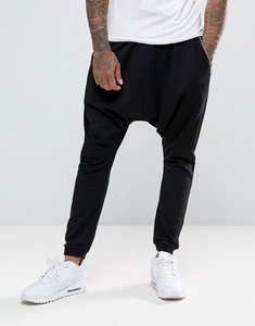 Read more about Asos lightweight extreme drop crotch jogger with zip pockets - black