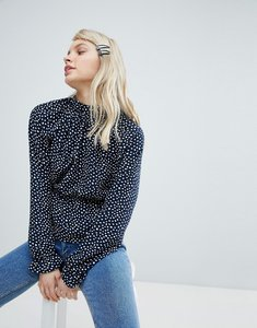 Read more about Monki high neck polka dot blouse - black and white
