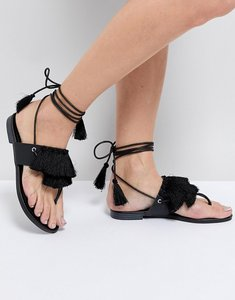 Read more about Truffle collection fringe tie up flat sandal
