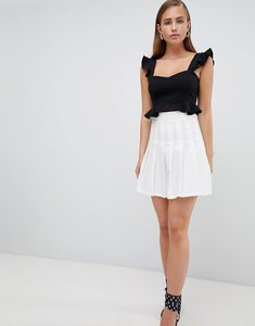 Read more about Prettylittlething pleated mini skirt - white