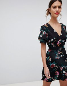 Read more about Liquorish floral print wrap dress with short sleeves - black