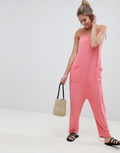 Read more about Asos design jersey minimal jumpsuit with ties - peach
