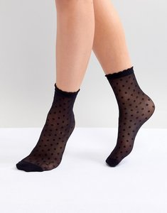 Read more about Monki polka dot mesh sock in black with dots - black with dots