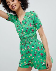 Read more about Bershka all over floral printed jumpsuit in green - green