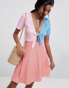 Read more about Asos design mini skater sundress with tie front in colour block gingham - gingham
