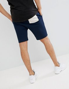Read more about Asos design jersey skinny shorts in navy with beige fabric interest pocket - navy