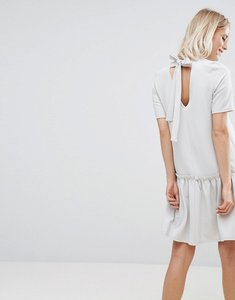 Read more about Asos swing dress with ruffle dropped hem and tie back - pale grey