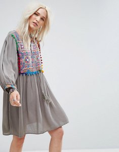 Read more about Glamorous smock dress with mirror embroidery and pom pom trim - grey