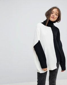 Read more about Bershka 2 tone knitted high neck jumper - black