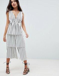 Read more about Asos design stripe tiered leg jumpsuit - black white