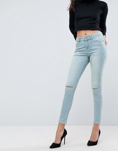 Read more about Asos lisbon skinny mid rise jeans in crocus wash with rips - light wash blue