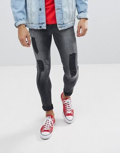 Read more about Asos extreme super skinny jeans in washed black with rips - washed black