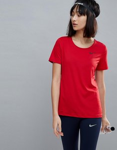 Read more about Nike pro training short sleeve tee in red - gym red black