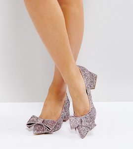 Read more about Asos sacred wide fit bow mid heels - pink glitter