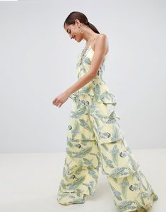 Read more about Asos design tiered jumpsuit with lace up front in tropical print - tropical