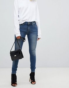 Read more about Asos lisbon in skinny mid rise jeans in elliot aged mid wash - mid wash blue