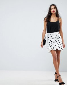 Read more about Asos high waisted mini puffball skirt in spot - white and black