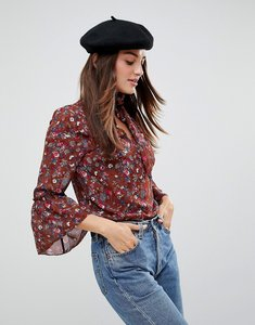 Read more about Parisian pussy bow floral blouse - rust