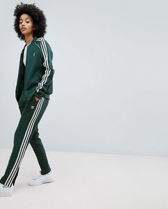 Read more about Adidas originals adicolor three stripe track pants in green - green