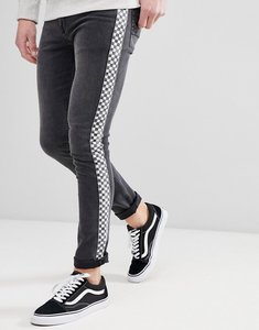 Read more about Asos design super skinny jeans in washed black with checkerboard stripe - washed black