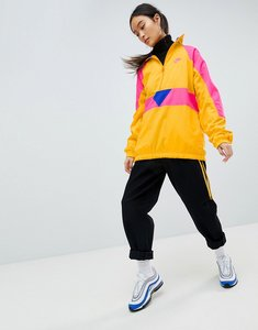 Read more about Nike vaporwave half zip track jacket in yellow with colour block - yellow