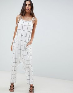Read more about Asos design jumpsuit minimal with ties in white check - white black