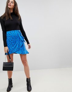 Read more about Asos mini wrap skirt in polka dot print - blue black