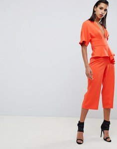 Read more about Lavish alice kimono sleeve peplum culotte jumpsuit - orange