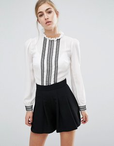 Read more about Miss selfridge ruffle high neck playsuit - white